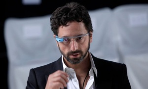 Google co-founder Sergey Brin dons a pair of Google Glasses // Seth Wenig/AP